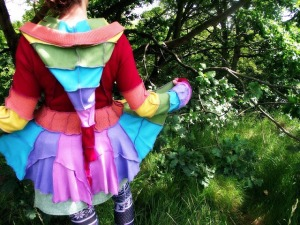 The old coat of remembering becomes a rainbow of possibilities